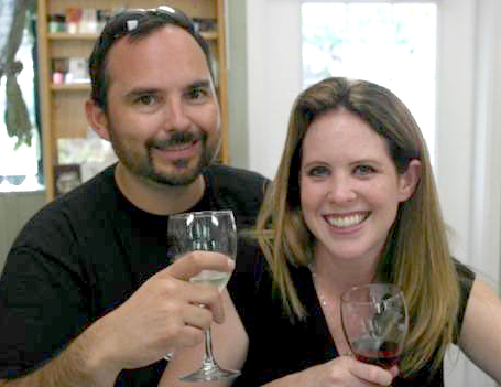 man and woman wine tasting