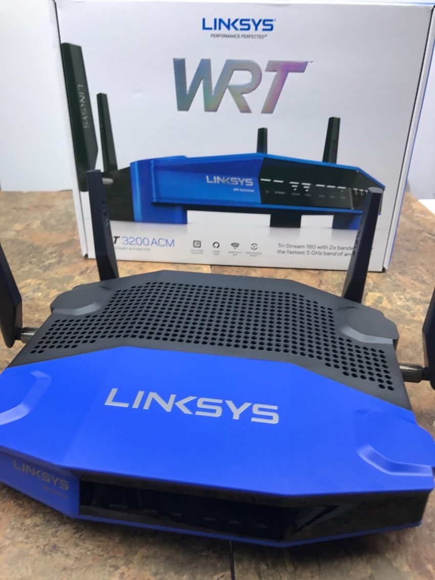 wireless router on table with box