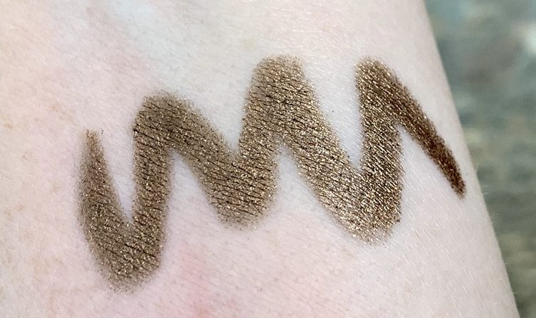 gold makeup swatch on arm
