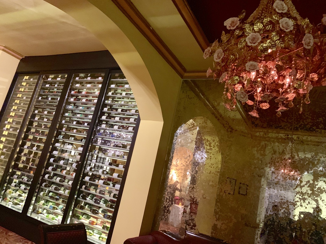 wine cellar with flower chandelier
