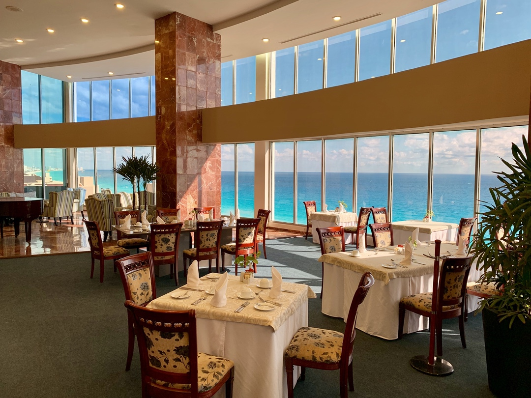 tables in a restaurant with ocean view