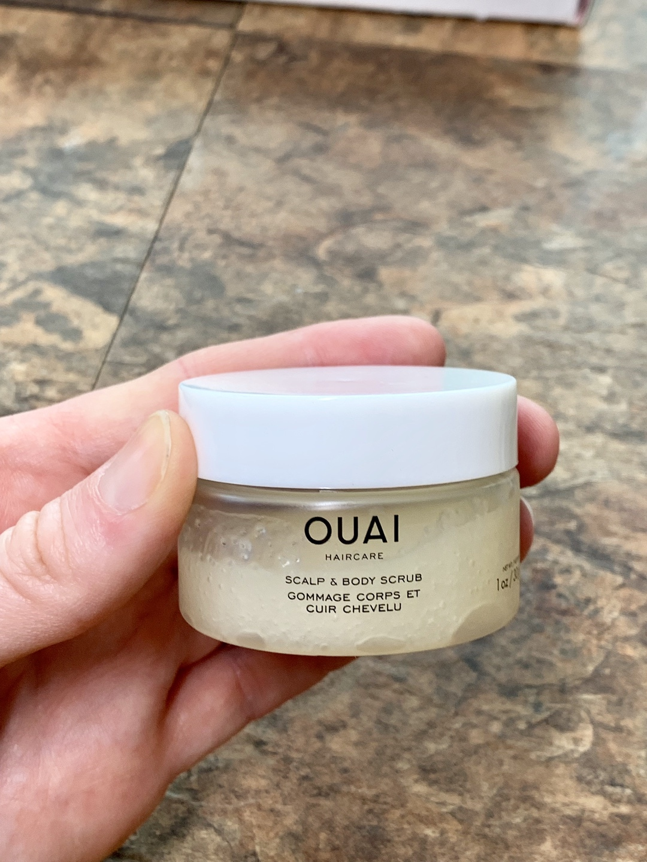 hand holding ouai product