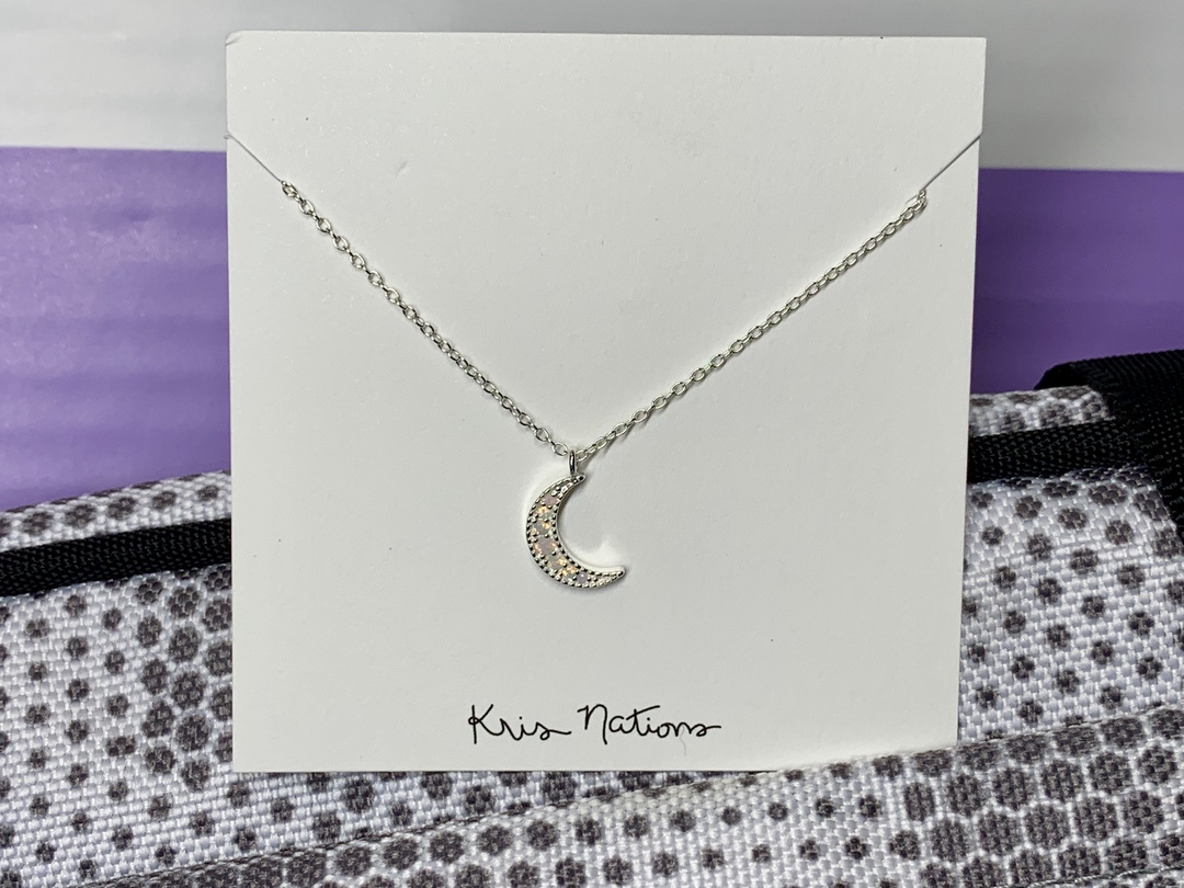 Silver moon necklace from popsugar spring box