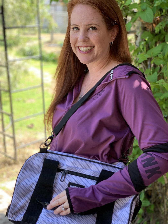 Woman holding duffel bag