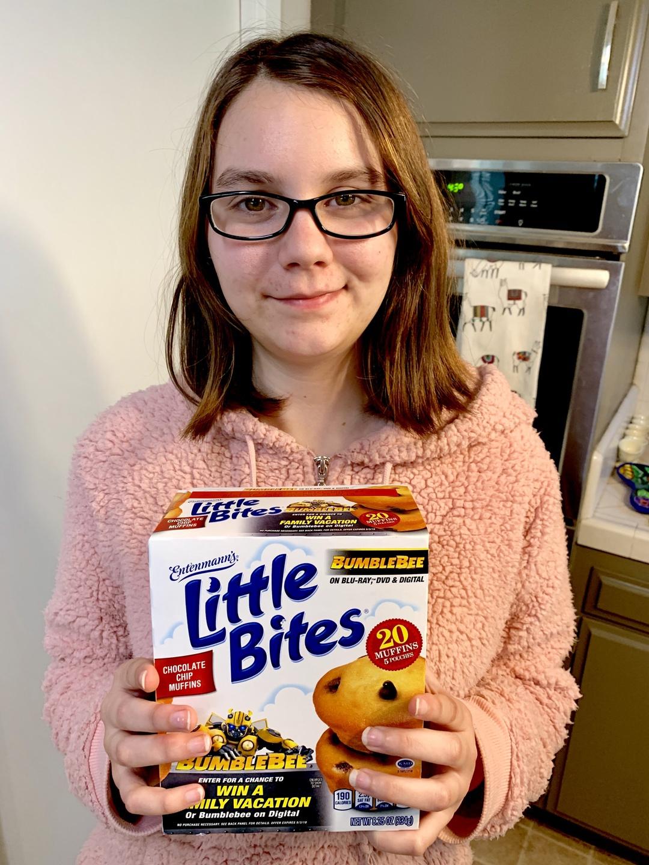 Girl holding box of Entenmann's Little Bites Muffins
