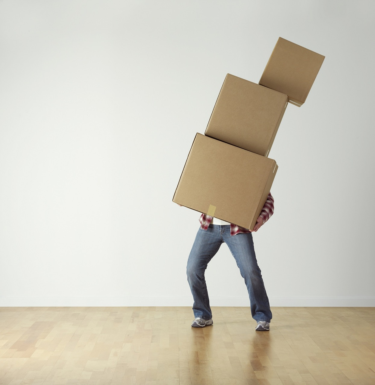 man holding pile of cardboard boxes need home organizer app