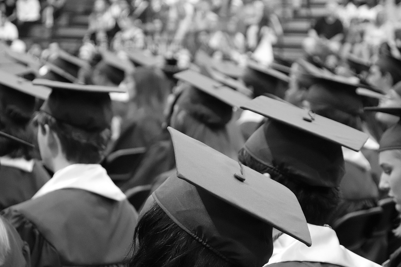 students in caps and gowns for graduation ceremony