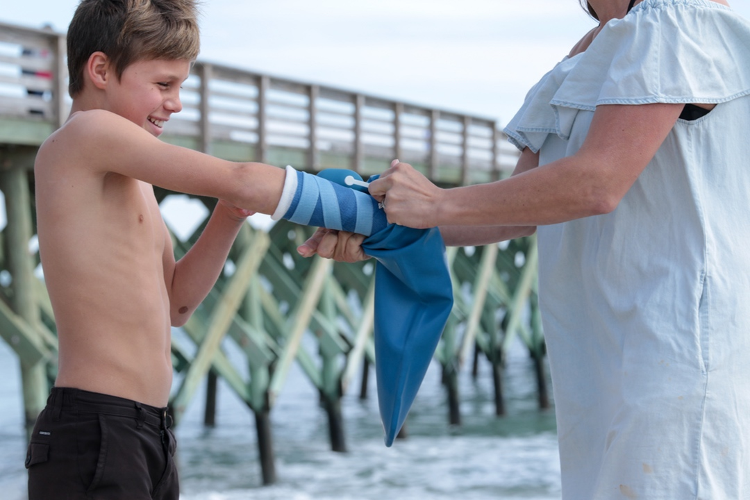 Boy with DryPro Cast Cover at beach