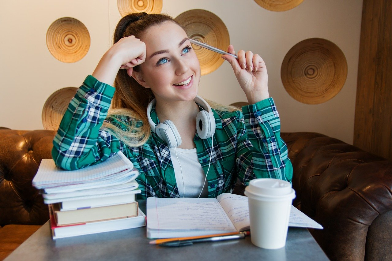 student with books and coffee