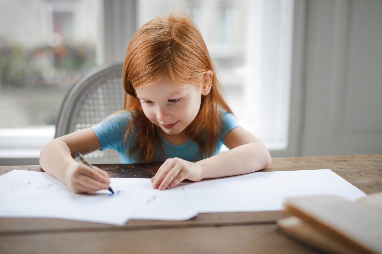 child with book homeschooling