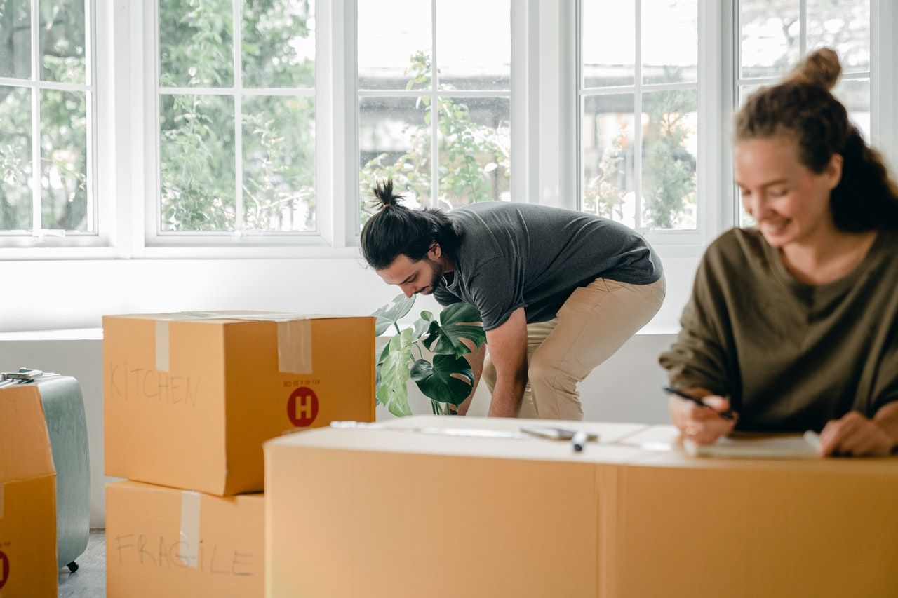 high five over packing boxes for moving