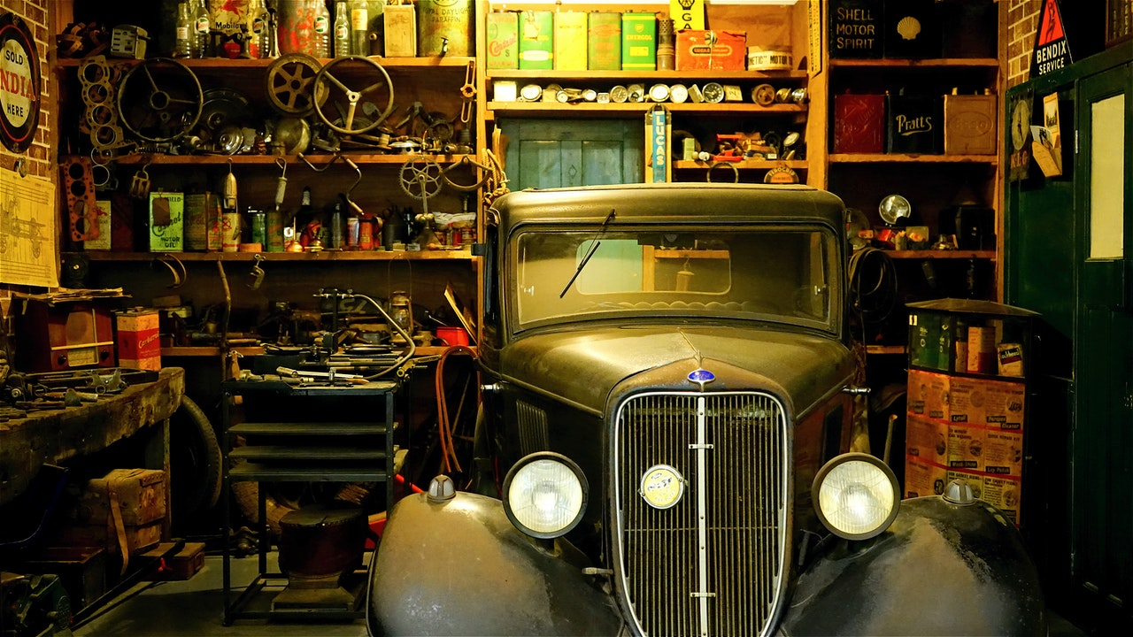 car in garage with tools