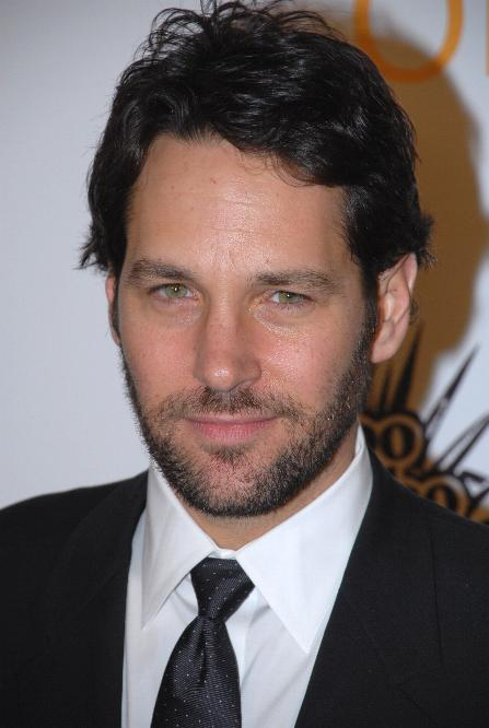 Paul Rudd wearing a suit and tie looking at the camera