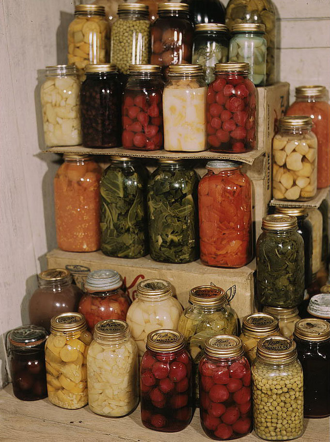 A bunch of jars that are sitting on a counter