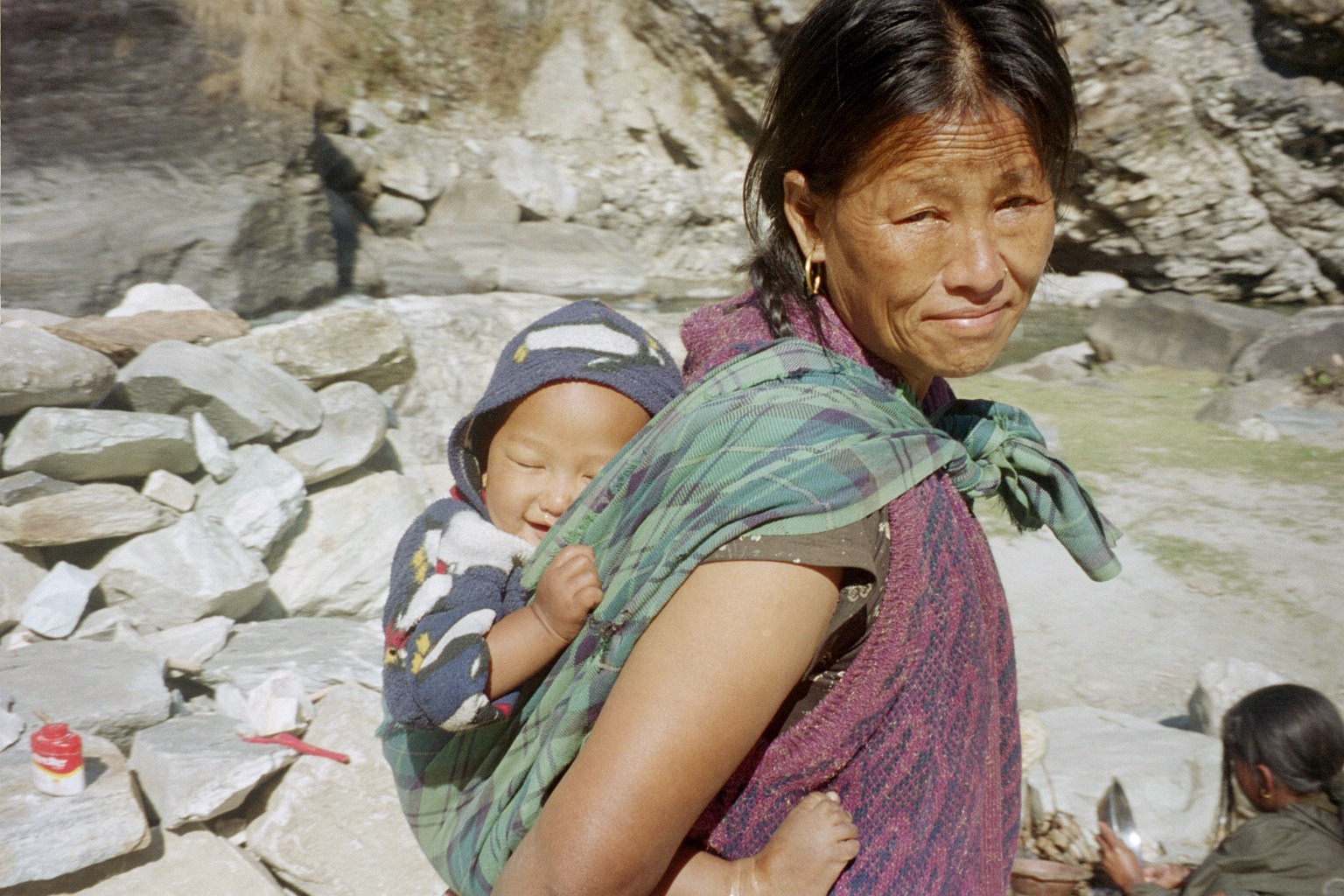 A person carrying a baby on their back