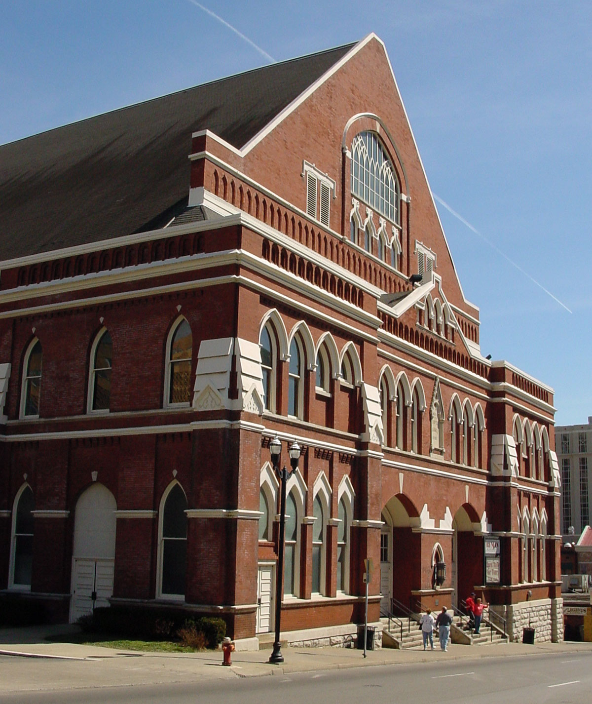 A large brick building with Ryman Auditorium in the background
